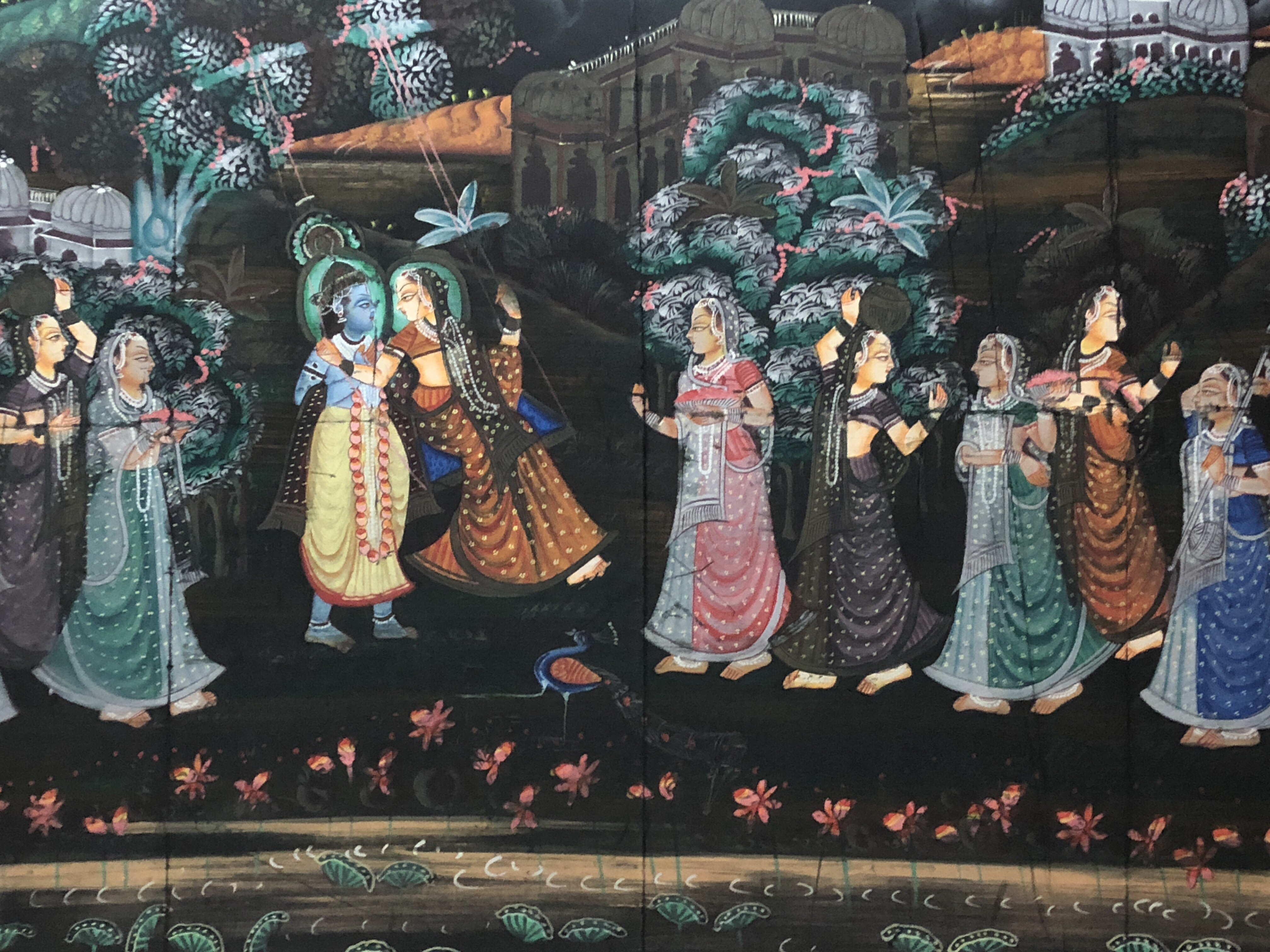Krishna dancing with gopis along Yamuna river